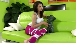 Observe the vicious brunette slut that posing on the sofa