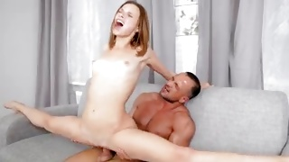 An acrobatic bitch is screaming while riding on cock