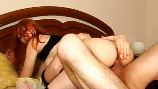 Messy red head bitch is riding on the yummy penis