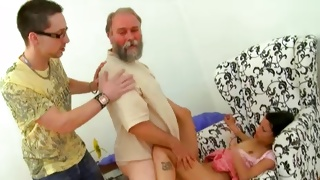 Skinny babe is kneeling in front of an old guy to cock suck