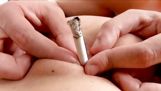 Horny guy is sliding a cigarette inside her anal