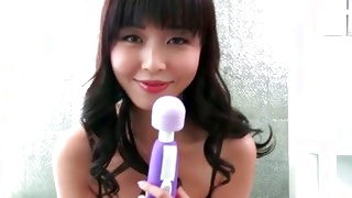 Chinese sexy bitch is seductively looking at perfect sex toy